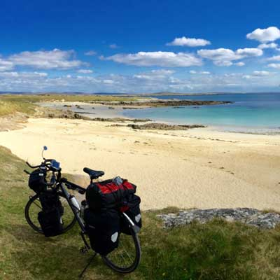 Bike rental break at a pristine beach in Ireland